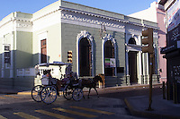 Horse and cart in city street in Merida, Mexico.