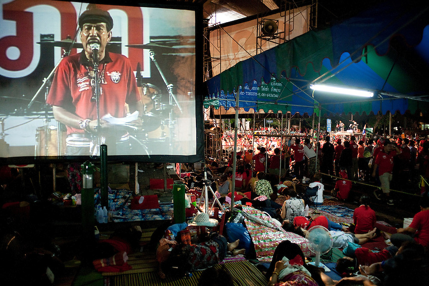 Red Shirts protesters are listening one of the leaders, Wiphuthalang, in the barricaded camp of Ratchaprasong, in the heart of Bangkok. He will surrender to police with other leaders the wednesday May 19 after the army laucnhed an assault against the camp one month later and is remaining in jail waiting a trial with others leaders ( updated: feb. 15 2011)