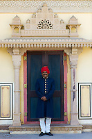 Palace guard in achkan suit at former Royal Guest House now textile museum in the Maharaja's Moon Palace, Jaipur, Rajasthan, India