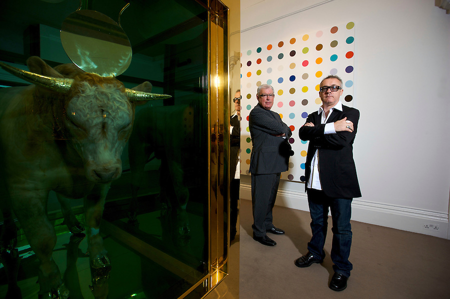 British artist Damien Hirst and his business manager Frank Dunphy pictured with some of Hirst's artworks which were sold in a two day auction at Sotheby's in London in September 2008, earning Hirst a reported £95 million.