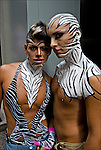 Gay Pride Parade,Colombian gay couple applying make up and body paint .as male and female zebras