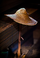 A straw hat finds a resting place on top of a pole.