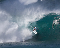 Josh Kerr of Australia in the pipe at 2011 Billabong Pipe Masters In Memory of Andy Irons, Banzai Pipeline on North Shore of Oahu..