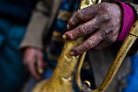 A Peruvian indigenous man holds a crumpled trumpet during the Yawar Fiesta, a ritual fight between the condor and the bull, held in the mountains of Apurímac, Cotabambas, Peru, 29 July 2012. The Yawar Fiesta (Feast of Blood), an indigenous tradition which dates back to the time of the conquest, consists basically of an extraordinary bullfight in which three protagonists take part - a wild condor, a wild bull and brave young men of the neighboring communities. The captured condor, a sacred bird venerated by the Indians, is tied in the back of the bull which is carefully selected for its strength and pugnacity. A condor symbolizes the native inhabitants of the Andes, while a bull symbolically represents the Spanish invaders. Young boys, chasing the fighting animals, wish to show their courage in front of the community. However, the Indians usually do not allow the animals to fight for a long time because death or harm of the condor is interpreted as a sign of misfortune to the community.