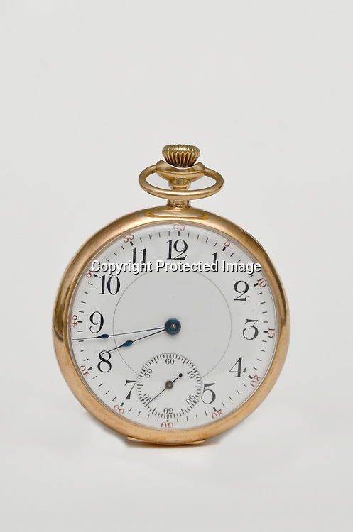 Stock photo of a gold pocket watch