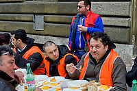 Roma 23 Dicembre 2014<br /> Pranzo di Natale davanti al Ministro del Lavoro e delle Politiche sociali, in Via Veneto, organizzato dal Comitato disoccupati per il lavoro minimo garantito, che vogliono incontrare il ministro Giuliano Poletti, e per protestare contro il Jobs Act.<br /> Rome December 23, 2014<br /> Christmas lunch in front of the Minister of Labor and Social Policies, in Via Veneto, organized by the Committee for the unemployed job guaranteed minimum, they want to meet the Minister Giuliano Poletti, and to protest against the Jobs Act.