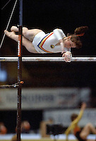 Ecaterina Szabo of Romania performs on uneven parallel bars at 1985 European Championships in women's artistic gymnastics at Helsinki, Finland in late April, 1985.  Photo by Tom Theobald.