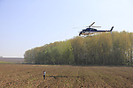 TV helicopter hovers over photographer Pim Nijland near Noyon during the 115th edition of the Paris-Roubaix 2017 race running 257km Compiegne to Roubaix, France. 9th April 2017.<br /> Picture: Eoin Clarke | Cyclefile<br /> <br /> <br /> All photos usage must carry mandatory copyright credit (&copy; Cyclefile | Eoin Clarke)