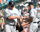 New York Yankees pitcher Bartolo Colon (40) hands the ball to manager Joe Girardi (28) after giving up a second run in the eighth inning against the Baltimore Orioles at Oriole Park at Camden Yards in Baltimore, Maryland in the first game of a doubleheader on Sunday, August 28, 2011.  The Orioles won the game 2 - 0..Credit: Ron Sachs / CNP.(RESTRICTION: NO New York or New Jersey Newspapers or newspapers within a 75 mile radius of New York City)
