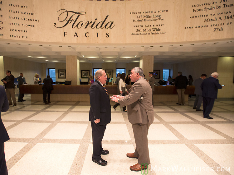 Lobbyist Paul Anderson, with the Fla Justice Association, right and Doug Mannheimer, with Broad and Cassel, talk on the fourth floor rotunda while the House and Senate debate at the Florida Capitol in Tallahassee, Florida.