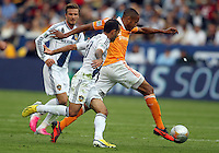 CARSON, CA - DECEMBER 01, 2012:   Juninho (19) of the Los Angeles Galaxy moves in on Ricardo Clark (13) of the Houston Dynamo during the 2012 MLS Cup at the Home Depot Center, in Carson, California on December 01, 2012. The Galaxy won 3-1.