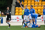 St Johnstone v Hibs...22.03.14    SPFL<br /> Referee Steven McLean sends off Danny Hayes for stamping on David Wotherspoon who lies injured<br /> Picture by Graeme Hart.<br /> Copyright Perthshire Picture Agency<br /> Tel: 01738 623350  Mobile: 07990 594431