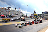 Sep 15, 2013; Charlotte, NC, USA; NHRA top fuel dragster driver Clay Millican (near lane) races alongside teammate Bob Vandergriff Jr during the Carolina Nationals at zMax Dragway. Mandatory Credit: Mark J. Rebilas-