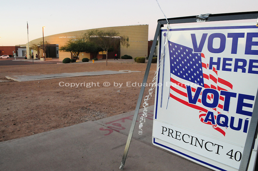 "Apache Junction, Arizona. November 6, 2012 - A bilingual ""Vote Here"" sign on a sidewalk next to Cactus Canyon Junior High School in Apache Junction, Arizona, in Pinal County (35 miles east of Phoenix), let voters know the school building is serving as a poll place for the Nov. 6 election. Photo by Eduardo Barraza © 2012"