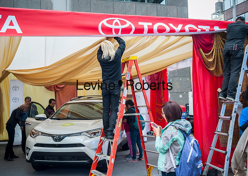 A Toyota promotional event at a street fair in New York on Sunday, October 2, 2016. New vehicle sales are reported to have fallen to $47 billion in September, 0.3% less than the same time last year.  (© Richard B. Levine)