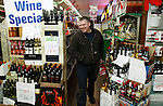 HARWINTON, CT 01/01/09- 010209BZ01- Patrick Roma, of Torrington, walks to the counter of Tony's Package Store on Rte. 4 in Harwinton with a six pack of Budweiser Friday night.<br /> Jamison C. Bazinet Republican-American