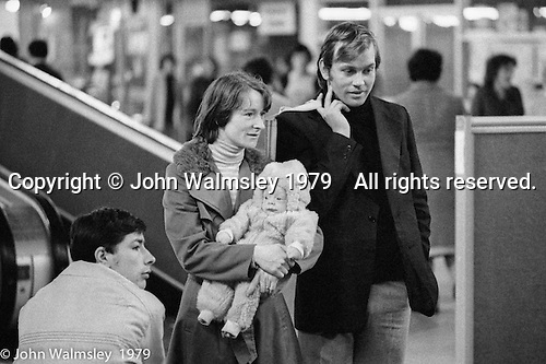 In the Shopping Centre, Wester Hailes, Scotland, 1979.  John Walmsley was Photographer in Residence at the Education Centre for three weeks in 1979.  The Education Centre was, at the time, Scotland's largest purpose built community High School open all day every day for all ages from primary to adults.  The town of Wester Hailes, a few miles to the south west of Edinburgh, was built in the early 1970s mostly of blocks of flats and high rises.