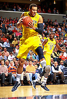 CHARLOTTESVILLE, VA- NOVEMBER 29: Jordan Morgan #52 of the Michigan Wolverines grabs a rebound during the game on November 29, 2011 at the John Paul Jones Arena in Charlottesville, Virginia. Virginia defeated Michigan 70-58. (Photo by Andrew Shurtleff/Getty Images) *** Local Caption *** Jordan Morgan