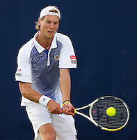 Andreas Seppi (ITA) against Bernard Tomic (AUS) in the first round of the men's singles. Bernard Tomic beat Andreas Seppi 6-3 5-7 6-3..Tennis - ATP World Tour - AEGON Championships - Queen's Club - London - Day 2 - Tues 08 Jun 2010..© AMN Images - Level 1, Barry House, 20-22 Worple Road, London, SW19 4DH.Tel - +44 (0) 208 947 0100.email - mfrey@advantagemedianet.com. www.photoshelter.com/c/amnimages.