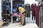 """Sawsan Al Khalili, 40 years-old, a Palestinian woman of special needs visits clothes market in Gaza city on Feb. 11, 2017. Al Khalili secretary general of the general union of the Palestinian disabled and a head of the Palestinian farsat club for women with disabilities and she has a degree in law and information technology. """"I defend the rights of the disabled and became their ambassador in six European countries"""" Al Khalili said. Photo by Samar Eliwa"""