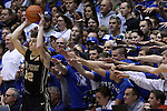 30 November 2014: Duke fans, the Cameron Crazies, try to distract Army's Tanner Plomb (32). The Duke University Blue Devils hosted the West Point Military Academy Army Black Knights at Cameron Indoor Stadium in Durham, North Carolina in a 2014-16 NCAA Men's Basketball Division I game. Duke won the game 93-73.