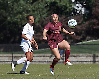 Virginia Tech forward Katie DeTuro (11) attempts to control the ball.Virginia Tech (maroon) defeated Boston College (white), 1-0, at Newton Soccer Field, on September 22, 2013.