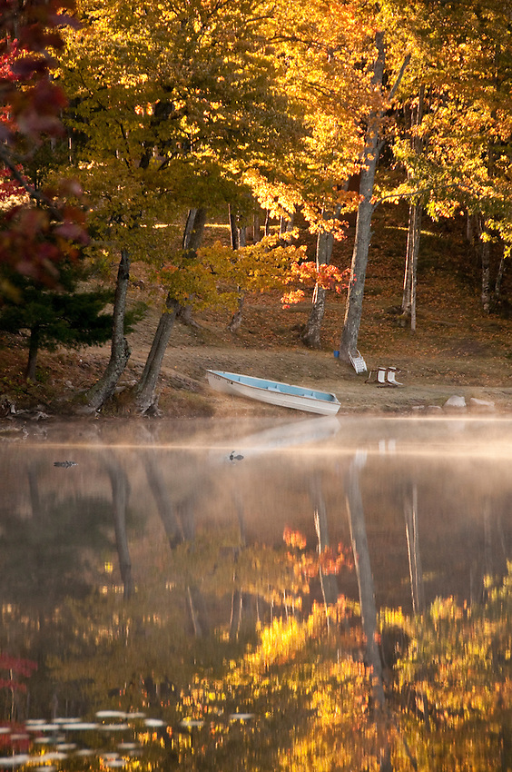 A rowboat and fall color at Ackerman Lake along M-94 near Munising Michigan in the Hiawatha National Forest.