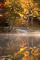 A rowboat and fall color at Ackerman Lake along M-94 near Munising Michigan in the Hiawatha National Forest.
