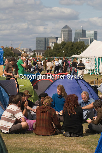 Climate Camp Blackheath south London UK. City of London in background. Campers in group meeting. 2009