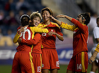 Ma Jun (13) of China celebrates her goal with teammate Zhou Gaoping (20) during an international friendly at PPL Park in Chester, PA.  The U.S. tied China, 1-1.