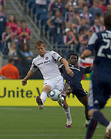 Chicago Fire forward Brian McBride (20) and New England Revolution defender Emmanuel Osei (5) battle at midfield. The Chicago Fire defeated the New England Revolution, 1-0, at Gillette Stadium on June 27, 2010.