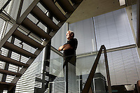 A portrait of architect Hans van Heeswijk photographed at his house in Amsterdam.
