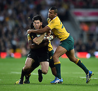 Nehe Milner-Skudder of New Zealand is tackled by Tevita Kuridrani and Kurtley Beale of Australia. Rugby World Cup Final between New Zealand and Australia on October 31, 2015 at Twickenham Stadium in London, England. Photo by: Patrick Khachfe / Onside Images