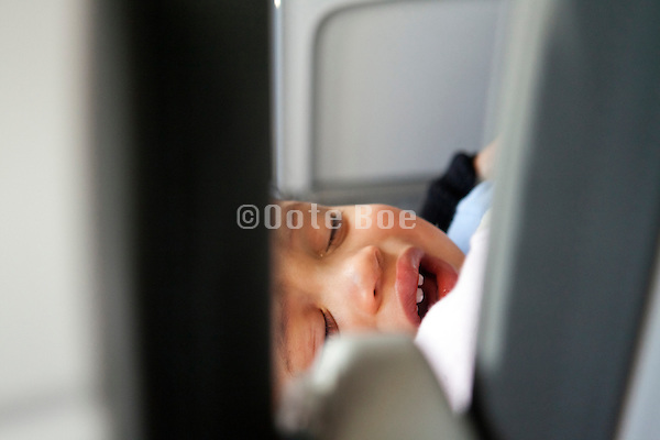crying little toddler in an airplane