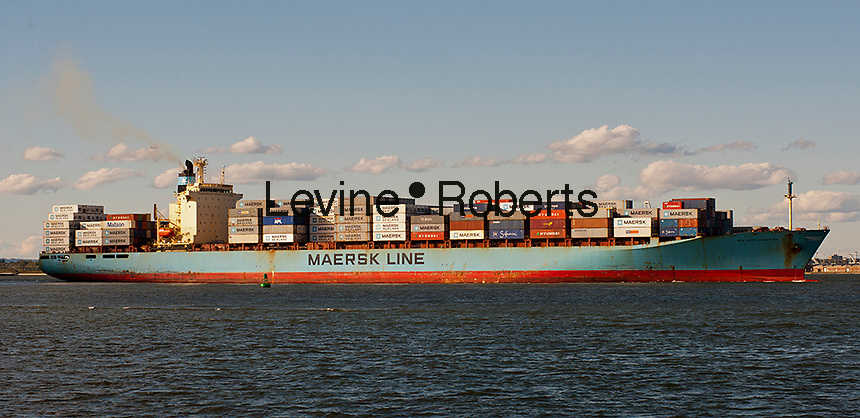 The Maersk line Sea Land Champion laden with containers leaves port in the New York and New Jersey harbor on Sunday, September 23, 2012.  (© Richard B. Levine)