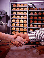 banker, insurance agent, baker, small business owner Bakery loaves of bread handshake