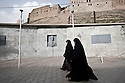 Iraq - Kurdistan - Erbil -  Muslim women walking by The Citadel.