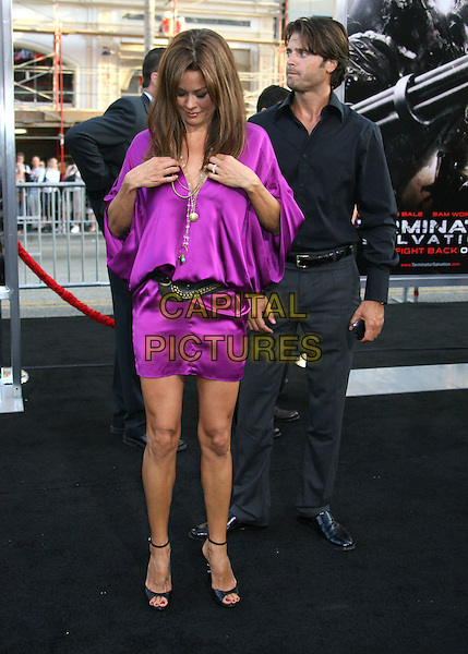 "BROOKE BURKE & DAVID CHARVET.""Terminator Salvation"" Los Angeles Premiere held at Grauman's Chinese Theatre, Hollywood, CA, USA..May 14th, 2009.full length married husband wife grey gray trousers black shirt purple silk satin dress open toe shoes necklaces belt looking down adjusting funny .CAP/ADM/MJ.©Michael Jade/AdMedia/Capital Pictures."