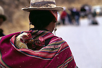Bolivian carrying chickens.