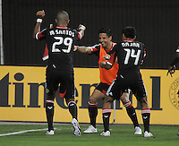 D.C. United forward Maicon Santos (29) celebrates his score in the 61th minute of the game with temmates Marcelo Saragosa and Andy Najar. D.C. United defeated The New England Revolution 3-2 at RFK Stadium, Saturday May 26, 2012.