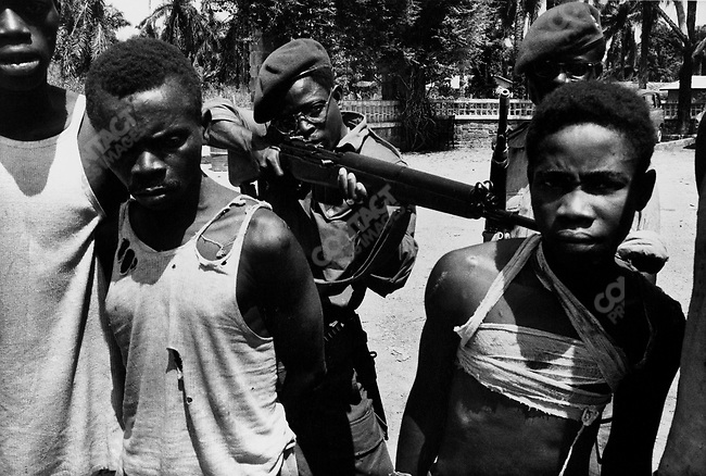 Suspected Lumumbist freedom fighters being tormented before execution, Stanleyville, Congo, 1964.