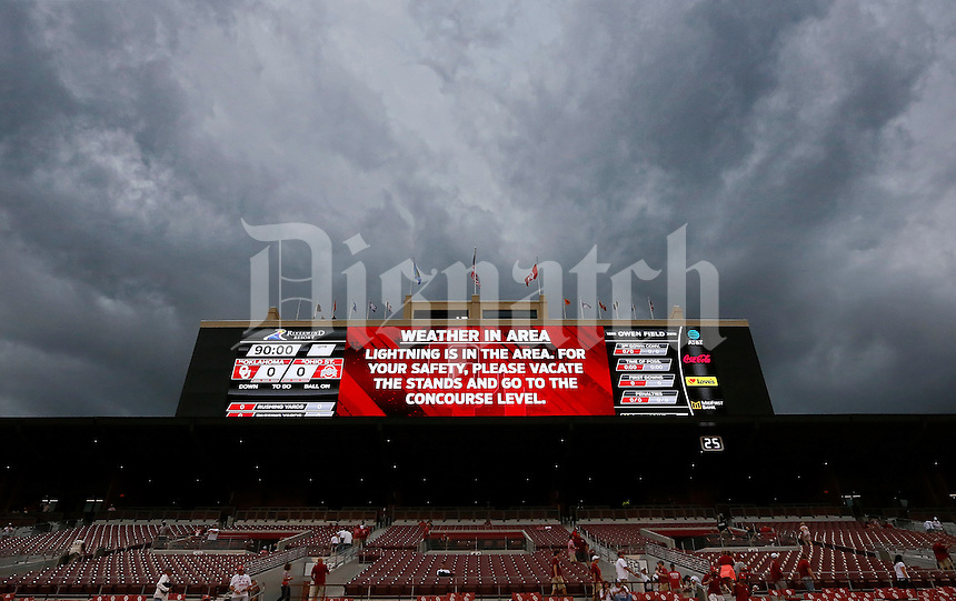 A sign on the jumbotron warns fans of inclement weather during a rain delay prior to Ohio State's NCAA football game against Oklahoma University at Memorial Stadium in Norman, Oklahoma on Sept. 17, 2016. (Adam Cairns / The Columbus Dispatch)