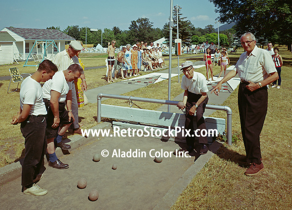 Perrellas Mountaindale Resort with men playing bocce and families playing shuffleboard
