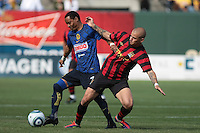 Adolfo Rosinei (left) battles against Vladimir Weiss (right) for the ball. Manchester City defeated Club America 2-0 in the Herbalife World Football Challenge 2011 at AT&T Park in San Francisco, California on July 16th, 2011.