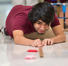 Physics students work on a project at Reagan High School, September 16, 2014.