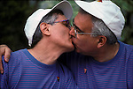 Gay couple David and David kissing, they have been living together for 20 years and want to get married but it is illegal in New York State they are at a Gay rights protest march in New York City..
