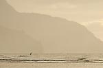 A paddleboarder heads out to see at Ke'e Beach on the Na Pali Coast, Kauai, Hawaii