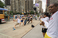 "Netflix promotes it original series ""Wet Hot American Summer, First Day of Camp"" with an event in Flatiron Plaza in New York on Tuesday, July 21, 2015. The promotion, which features tug o' war games with prizes for participants, was themed for the program, a prequel of the 2001 movie featuring almost all the same actors, playing as adults, younger versions of their characters.  All episodes will be available starting July 31 for your binge watching pleasure.  (© Richard B. Levine)"