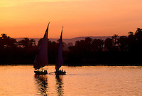 Three feluccas sailing peacefully on the River Nile at Luxor, Egypt