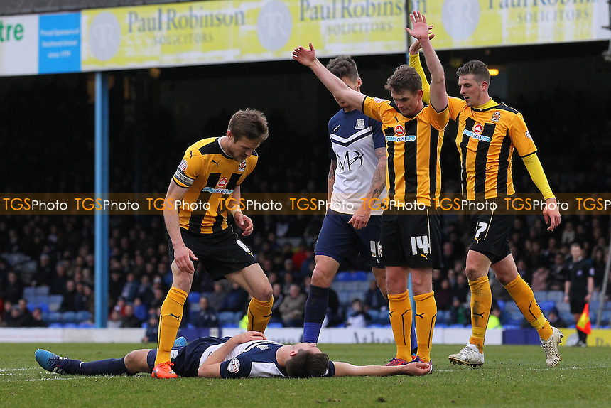 Injury concern for Luke Prosser of Southend United (on ground) - Southend United vs Cambridge United - Sky Bet League Two Football at Roots Hall, Southend-on-Sea, Essex - 21/03/15 - MANDATORY CREDIT: Gavin Ellis/TGSPHOTO - Self billing applies where appropriate - contact@tgsphoto.co.uk - NO UNPAID USE